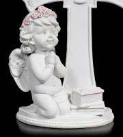 White Cherub Figurine praying in front of Cross