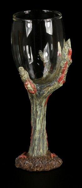 Zombiehand hält Glas