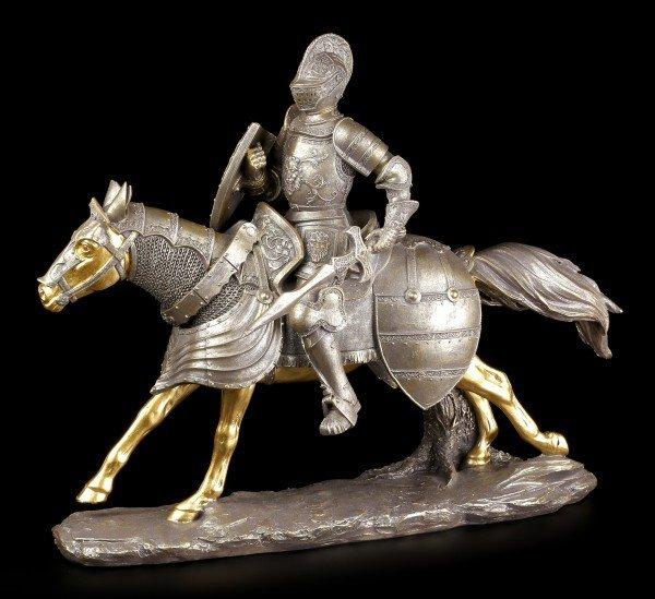 Ritter Figur auf goldenem Pferd mit Schwert