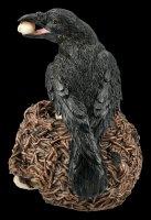Raben Figur auf Totenschädel-Nest