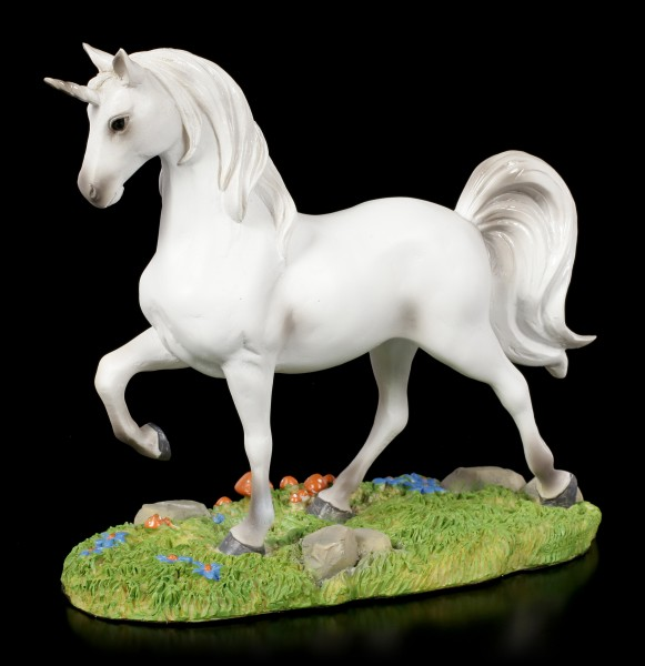 White Unicorn Figurine on Meadow