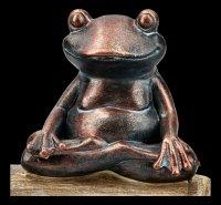 Frosch Figuren beim Meditieren