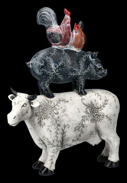 Hühner auf Schwein auf Kuh Figur