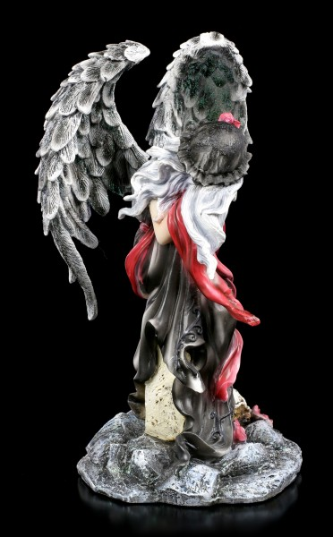 Dark Weeping Angel Figurine on Grave