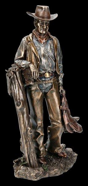 Cowboy Figurine - With Saddle on Tree Stump