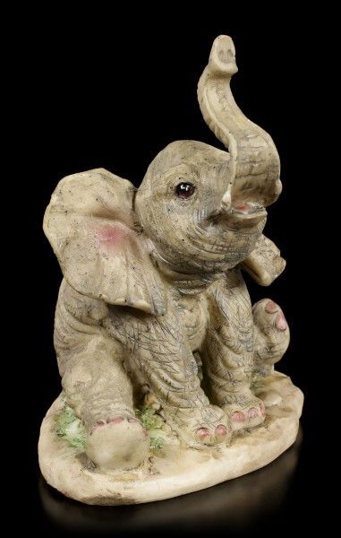 Elefanten Figur - Junges sitzend mit erhobenem Rüssel