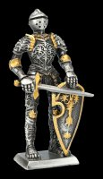 Pewter Knight Figurine holds Sword in front of Shield
