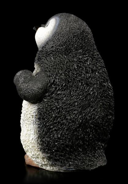 Baby Pinguin Figur lachend
